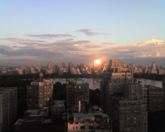 What I describe on page 364 -- the view from my terrace as the sun set behind me and reflected off a building across Central Park