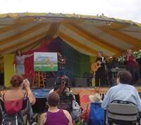 Betsy Franco Feeney turns the pages of the giant book at Clearwater Festival